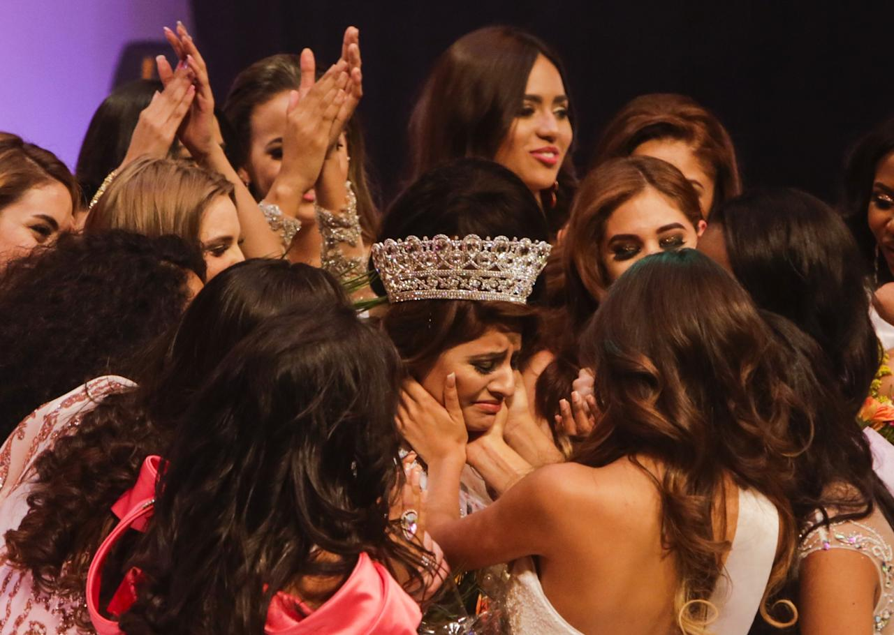 <p>Srishti Kaur from India cries during her celebration after winning the Miss Teen Universe Pageant in Managua on April 25, 2017. <br />INTI OCON / AFP </p>