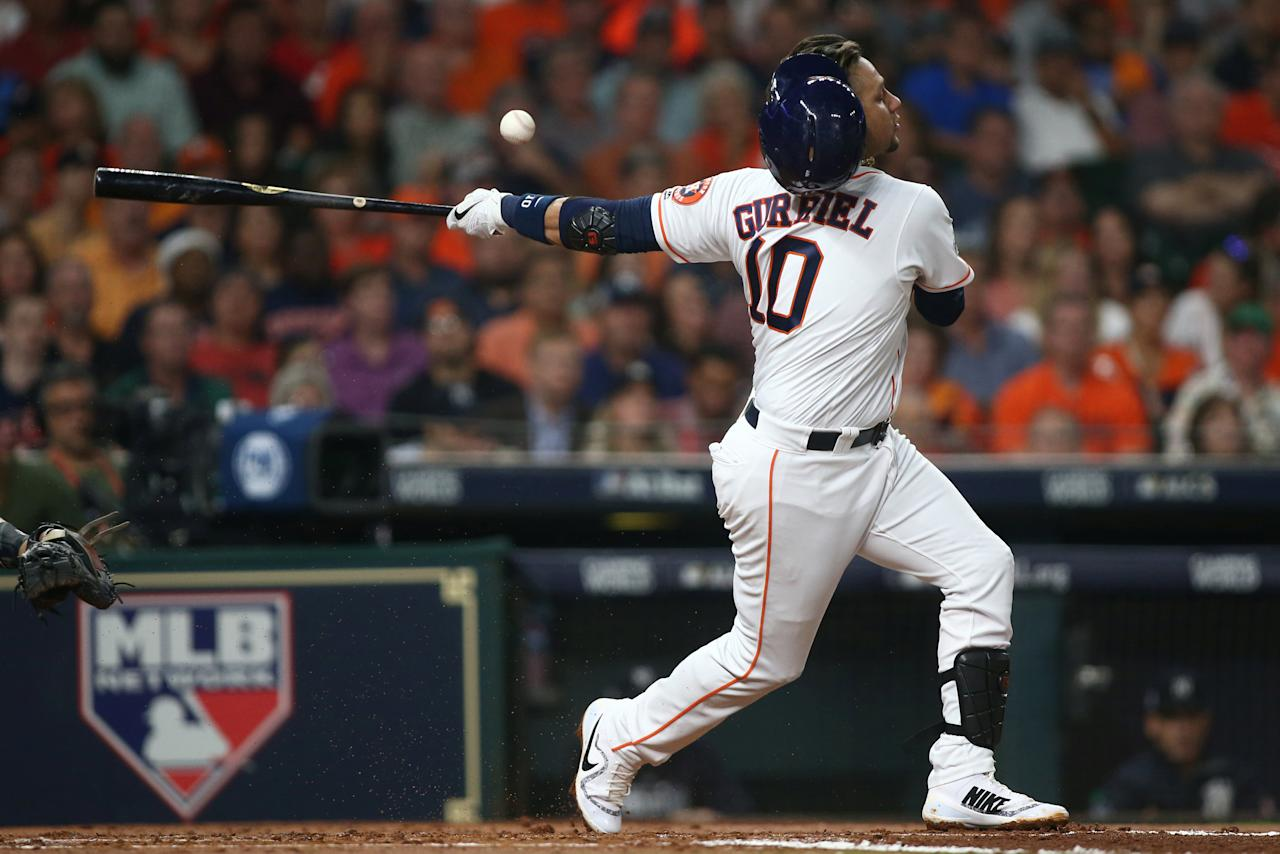 Oct 20, 2017; Houston, TX, USA; Houston Astros first baseman Yuli Gurriel (10) loses his helmet as he swings at a pitch against the New York Yankees in the second inning during game six of the 2017 ALCS playoff baseball series at Minute Maid Park. Mandatory Credit: Troy Taormina-USA TODAY Sports     TPX IMAGES OF THE DAY
