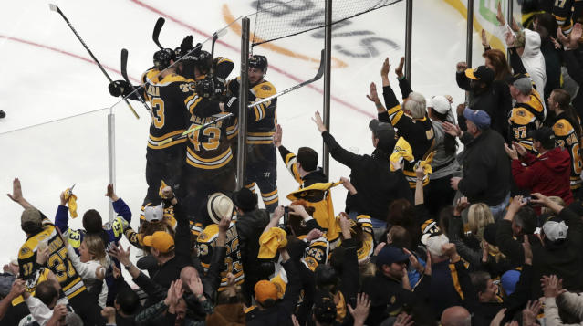 Boston Bruins fans celebrate after a goal by Bruins center Sean Kuraly (52) against the Toronto Maple Leafs during the third period of Game 7 of an NHL hockey first-round playoff series, Tuesday, April 23, 2019, in Boston. (AP Photo/Charles Krupa)