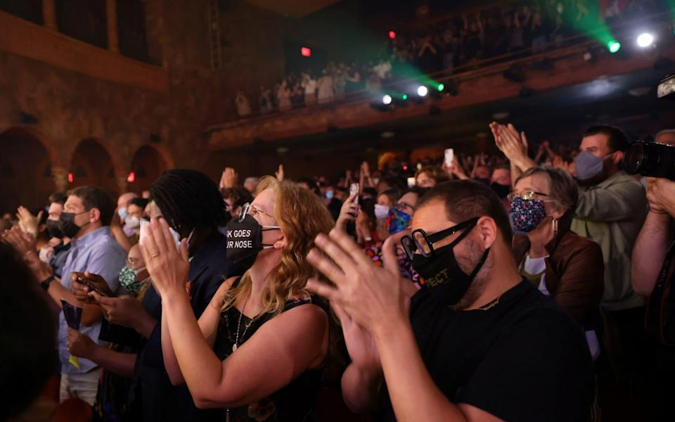 """The audience at the August Wilson Theatre in New York City gives a standing ovation after watching the opening night of previews for """"Pass Over,"""" following the 17-month shutdown of Broadway due to the pandemic - Caitlin Ochs/Reuters"""