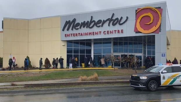 People lined up for testing at Membertou Entertainment Centre earlier this week. (Matthew Moore/CBC - image credit)