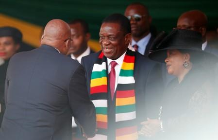 Zimbabwean President Mnangagwa welcomes former president of South Africa, Zuma ahead of the state funeral of Mugabe, at the national sports stadium in Harare