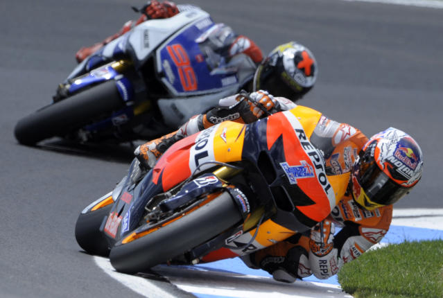 Repsol Honda team's Australian Casey Stoner rides ahead of Yamaha Factory Racing team's Spanish Jorge Lorenzo during the Moto GP race of the Portuguese Grand Prix in Estoril, outskirts of Lisbon, on May 6, 2012. Stoner won the race ahead of Spain's Lorenzo and Dani Pedrosa. AFP PHOTO / MIGUEL RIOPAMIGUEL RIOPA/AFP/GettyImages
