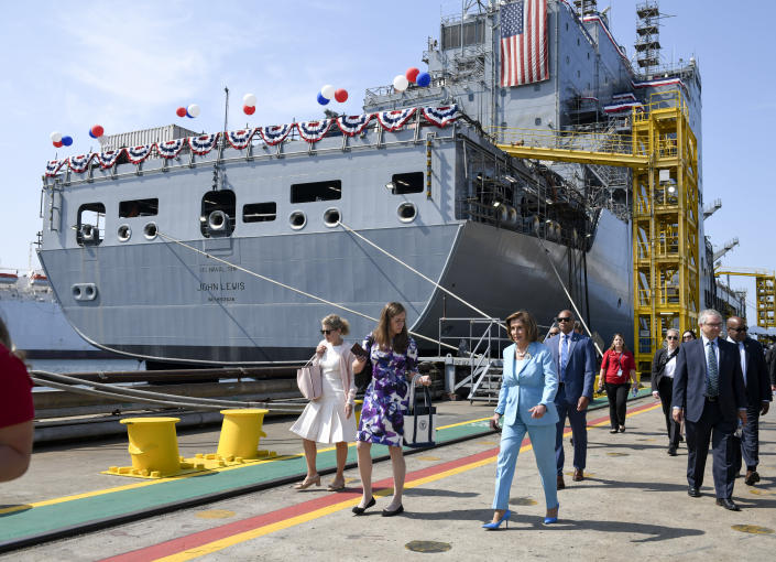 Speaker of the House Nancy Pelosi walks past the USNS John Lewis after a christening ceremony Saturday July 17, 2021, in San Diego. (AP Photo/Denis Poroy)