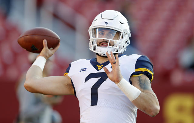 FILE - In this Saturday, Oct. 13, 2018 file photo, West Virginia quarterback Will Grier warms up before an NCAA college football game against Iowa State in Ames, Iowa. Grier has thrown 28 touchdown passes this season and will look for more when West Virginia plays TCU Saturday, Nov. 10, 2018, in Morgantown, W.Va. (AP Photo/Charlie Neibergall, File)