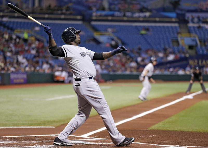 Boston Red Sox's David Ortiz hits a first-inning, three-run home run off Tampa Bay Rays starting pitcher Matt Moore during a baseball game Tuesday, May 14, 2013, in St. Petersburg, Fla. Red Sox's Jacoby Ellsbury, and Shane Victorino also scored on the hit. (AP Photo/Chris O'Meara)