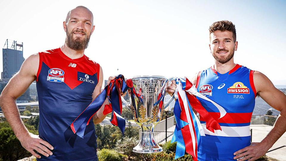 Max Gawn (pictured left) and Marcus Bontempelli (pictured right) hold the AFL grand final trophy.