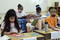 In this photo provided by Charlotte-Mecklenburg Schools, second-grade students at McAlpine Elementary School take part in the classroom learning portion of Camp CMS, Charlotte-Mecklenburg Schools' summer program, in Charlotte, NC, Thursday June 17, 2021. Across the country, school districts were able to greatly expand their summer offerings by leveraging federal pandemic relief funding. (Nancy Pierce/Charlotte-Mecklenburg Schools via AP)
