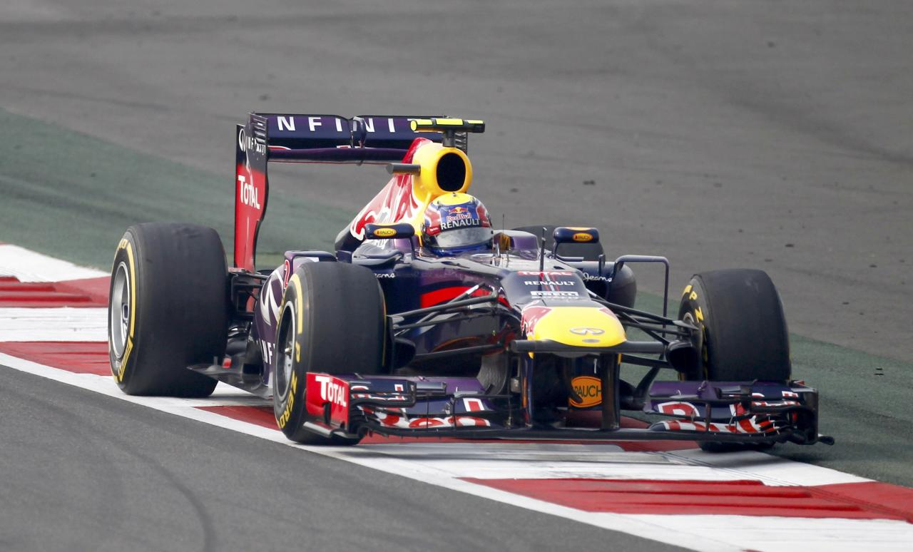 Red Bull Formula One driver Mark Webber of Australia drives during the qualifying session of the Indian F1 Grand Prix at the Buddh International Circuit in Greater Noida, on the outskirts of New Delhi, October 26, 2013. REUTERS/Anindito Mukherjee (INDIA - Tags: SPORT MOTORSPORT F1)