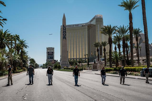 Members of the FBI sweep a stretch of South Las Vegas Boulevard, which is still closed to the public, near the Mandalay Bay Hotel and the site of the Sunday mass shooting that claimed the lives of 58 people and injured hundreds more in Las Vegas. (Photo: Nick Otto via ZUMA Wire)