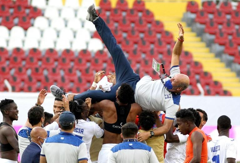 Honduras players lift coach Miguel Falero as they celebrate their passage to the Tokyo Olympics with a 2-1 victory over the United States in the CONCACAF Olympic qualifying tournament