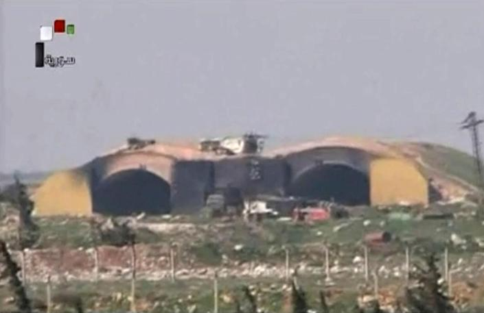 <p>This frame grab from video provided by Syrian official TV, shows the burned and damaged hangar attacked by U.S. Tomahawk missiles at the Shayrat air base, southeast of Homs, Syria, on April, 7, 2017. (Syrian government TV, via AP) </p>