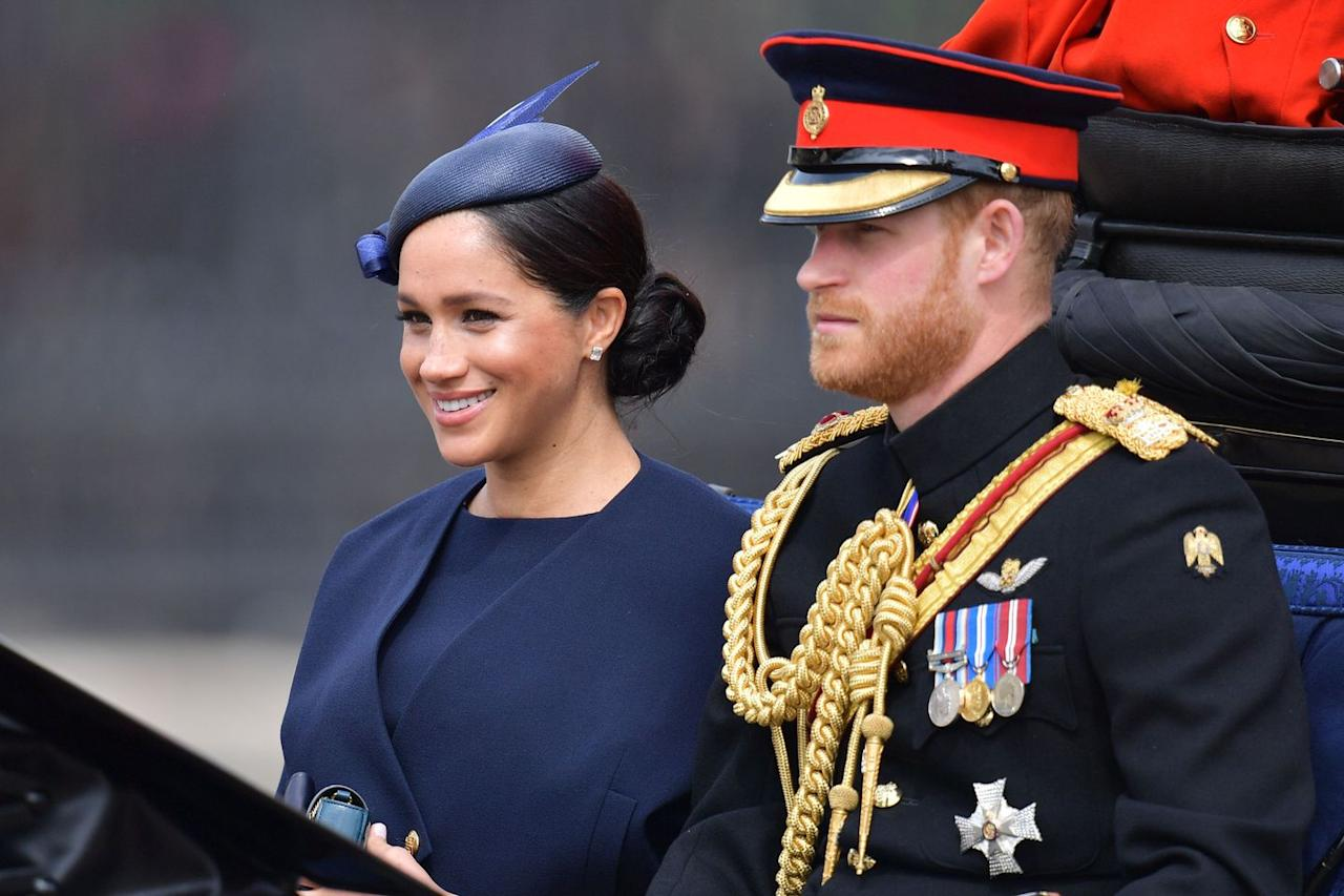 <p>Meghan and Harry arrive at the parade via carriage.</p>