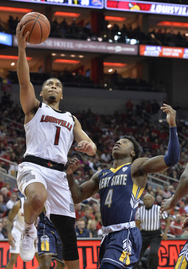 Louisville guard Christen Cunningham (1) goes in for a layup past the defense of Kent State guard Antonio Williams (4) during the second half of an NCAA college basketball game in Louisville, Ky., Saturday, Dec. 15, 2018. Louisville won 83-70. (AP Photo/Timothy D. Easley)