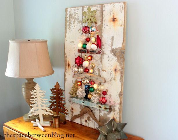 """<p>The driftwood in this DIY mimics branches on a Christmas tree when attached to a rustic piece of wood and lined with Christmas ornaments — and suddenly you have a vintage-inspired decoration for your credenza.</p><p><a href=""""http://thespacebetweenblog.net/upcycling-idea-christmas-tree-craft/"""" rel=""""nofollow noopener"""" target=""""_blank"""" data-ylk=""""slk:Get the tutorial at The Space Between »"""" class=""""link rapid-noclick-resp""""><em>Get the tutorial at The Space Between »</em></a> </p>"""