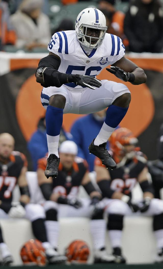 Indianapolis Colts linebacker Daniel Adongo jumps in the air just prior to receiving a kickoff in the first half of an NFL football game against the Cincinnati Bengals, Sunday, Dec. 8, 2013, in Cincinnati. Adongo is a rugby player from South Africa playing in his first football game. (AP Photo/Al Behrman)