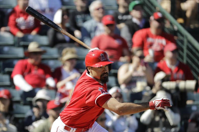 Los Angeles Angels' Anthony Rendon hits an RBI single during the second inning of a spring training baseball game against the Cincinnati Reds, Tuesday, Feb. 25, 2020, in Tempe, Ariz. (AP Photo/Darron Cummings)