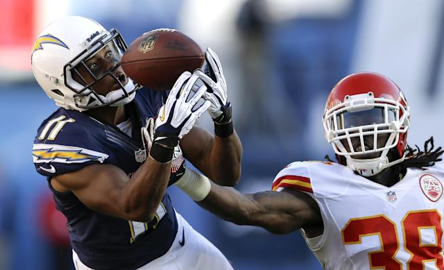 San Diego Chargers wide receiver Eddie Royal, left, can't hold on to a pass as Kansas City Chiefs defensive back Ron Parker defends during the second half of an NFL football game, Sunday, Dec. 29, 2013, in San Diego. (AP Photo/Lenny Ignelzi)