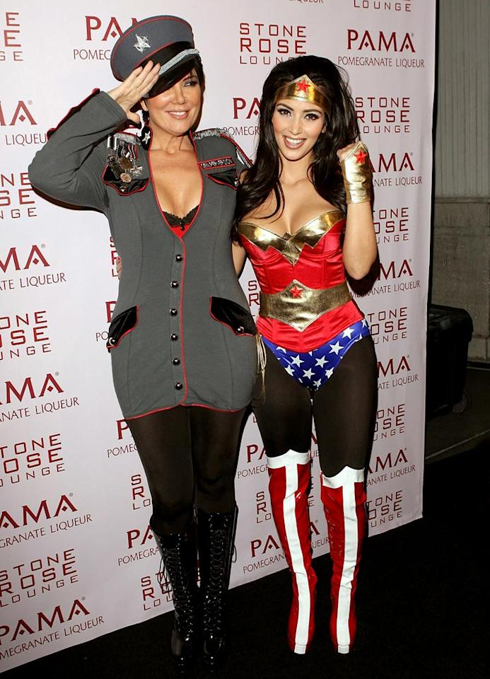 "Kim donned a Wonder Woman costume, while mom Kris Jenner wore a military-themed getup called General Perversion. Jesse Grant/<a href=""http://www.wireimage.com"" target=""new"">WireImage.com</a> - October 30, 2008"