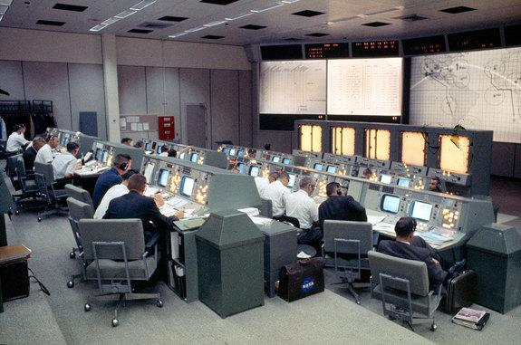 Mission Control in Houston as seen staffed for the Gemini 4 mission when it became active for the first time in NASA's histo