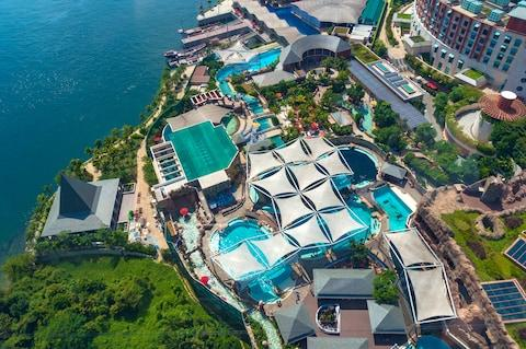 The island is two square miles of hotels and theme parks - Credit: GETTY