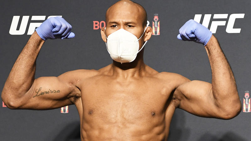 Ronaldo 'Jacare' Souza is pictured wearing a mask and gloves at the weigh-in for UFC 249.