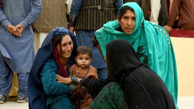 Relatives react in front of a hospital, where their family member has been transferred for treatment after a truck bomb blast in Balkh province, in Mazar-i-Sharif, Afghanistan August 25, 2020.
