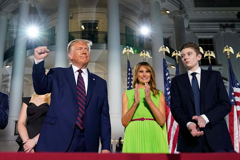 President Donald Trump, first lady Melania Trump and Barron Trump stand on the South Lawn of the White House on the fourth day of the Republican National Convention (AP)