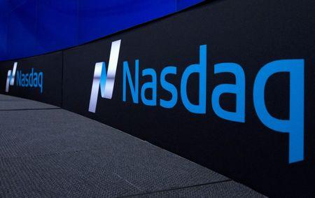 FILE PHOTO: The Nasdaq logo is displayed at the Nasdaq Market site in New York September 2, 2015. REUTERS/Brendan McDermid/File Photo
