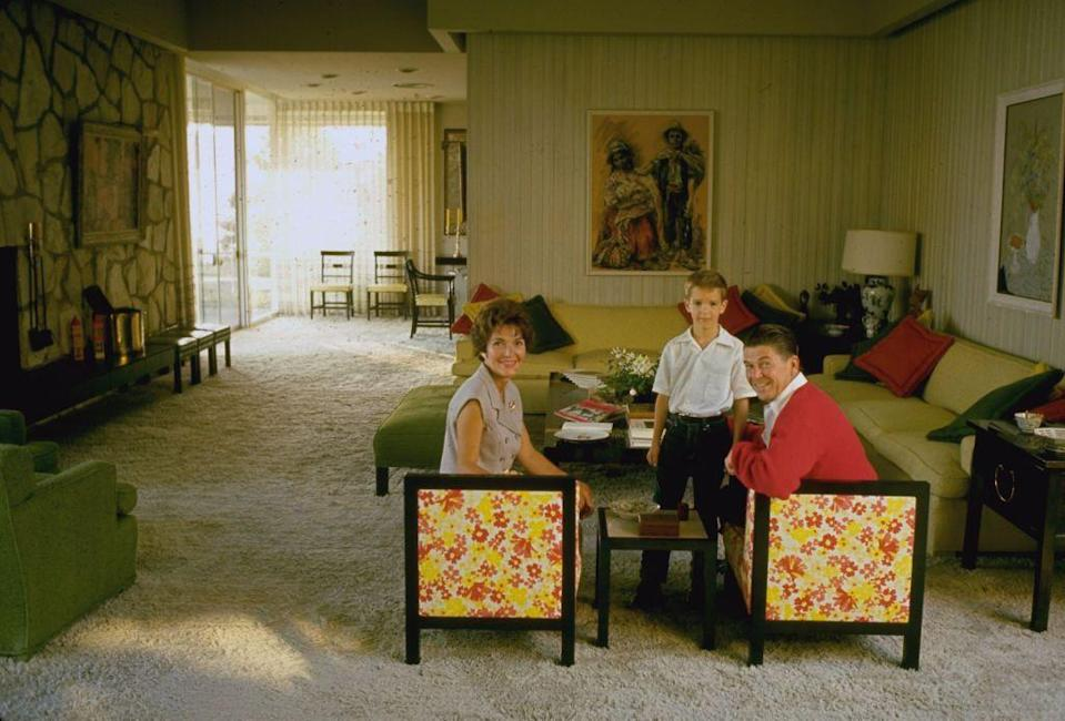 <p>Nancy, Ronald, and their son, Ronald (Ron) Reagan Jr. are pictured in their California living room. </p>