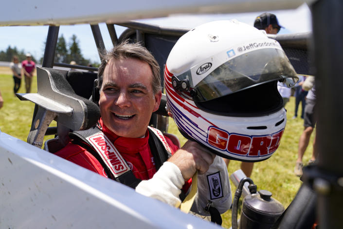 Jeff Gordon, a five-time winner of the Brickyard 400 and four-time NASCAR Cup Series champion, prepares to drive a USAC midget car during an exhibition on the dirt track in the infield at Indianapolis Motor Speedway in Indianapolis, Thursday, June 17, 2021. (AP Photo/Michael Conroy)