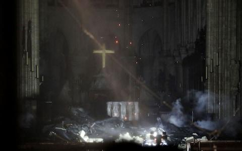 Inside Notre-Dame amid the ashes - Credit: Rex