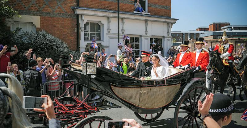 London: Prince Harry, Duke of Sussex and Meghan, Duchess of Sussex leave Windsor Castle in Ascot Landau carriage during a procession after getting married at St Georges Chapel