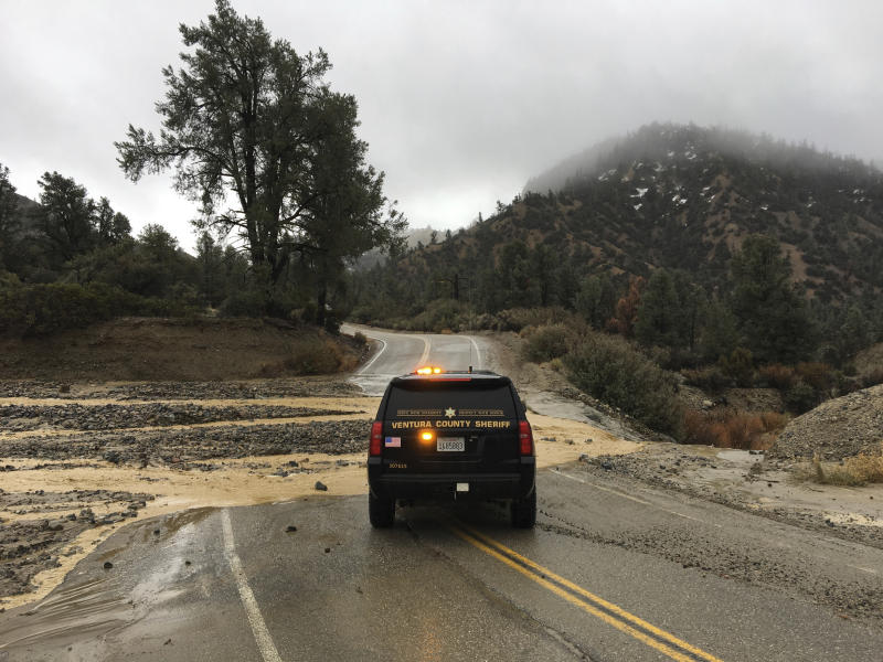 This Thursday, Jan. 17, 2019 photo provided by the Ventura County Sheriff's Dept. shows a flooded out crossing of Reyes Creek in Lockwood Valley in Ventura County, Calif. Californians were cleaning up and drying off Friday after a series of storms dumped heavy rain and snow throughout the state, caused at least six deaths and forced the rescue of more than a dozen people in rushing rivers. (Ventura County Sheriff's Dept. via AP)