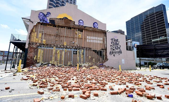 The rubble of a wall lies off the side of The Little Gem Saloon jazz club in New Orleans on Monday, Aug. 30, 2021, after Hurricane Ida came ashore in Louisiana on Sunday, Aug. 29, 2021.