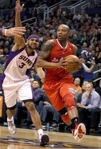 Los Angeles Clippers' Caron Butler, right, drives the baseline past Phoenix Suns' Jared Dudley during the first half of an NBA basketball game Sunday, Dec. 23, 2012, in Phoenix. (AP Photo/Ralph Freso)