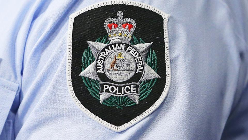 The Australian Federal Police badge, pictured here at a press conference.