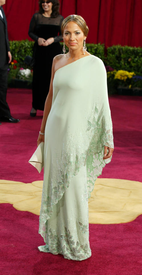 <p>A one-shoulder, green Valentino gown was J Lo's piece for the 2003 Oscars. Sophisticated and a beautiful apple green colour, it was a fantastic choice for the singer. </p>