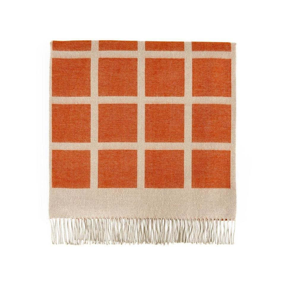 """<p><strong>Jonathan Adler</strong></p><p><strong>$345.00</strong></p><p><a href=""""https://go.redirectingat.com?id=74968X1596630&url=https%3A%2F%2Fjonathanadler.com%2Fproducts%2Fsquares-baby-alpaca-throw%3Fcolor%3DOchre%26Color%3DOrange%26variant_id%3D39680426803234&sref=https%3A%2F%2Fwww.elledecor.com%2Fshopping%2Fhome-accessories%2Fg37938966%2Fbest-pumpkin-spice-decor%2F"""" rel=""""nofollow noopener"""" target=""""_blank"""" data-ylk=""""slk:Shop Now"""" class=""""link rapid-noclick-resp"""">Shop Now</a></p><p>This graphic alpaca throw is basically the pumpkin-spice bars of sofa styling.</p>"""