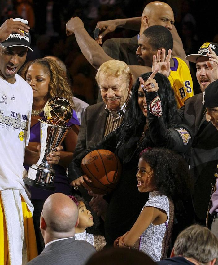 Owner Jerry Buss joins Kobe Bryant's family and Lakers teammates as they celebrate winning the 2010 NBA championship.