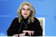 FILE - In this Thursday, Dec. 10, 2020 file photo, Russian Deputy Prime Minister Tatyana Golikova speaks to the media in Moscow, Russia. Russia's updated statistics on coronavirus-linked deaths show that 162,429 people with COVID-19 had died in the pandemic last year, a number much higher than previously reported by government officials. The state statistics agency, Rosstat, released figures for December on Monday, Feb. 8, 2021 updating its count of coronavirus-linked deaths that includes cases where the virus wasn't the main cause of death and where the virus was suspected but not confirmed. (Dmitry Astakhov/Sputnik, Kremlin Pool Photo via AP, File)
