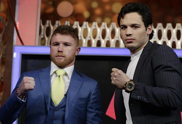 Canelo Alvarez and Julio Cesar Chavez Jr. are both revered by Mexicans and Hispanic-American boxing fans. (AP)