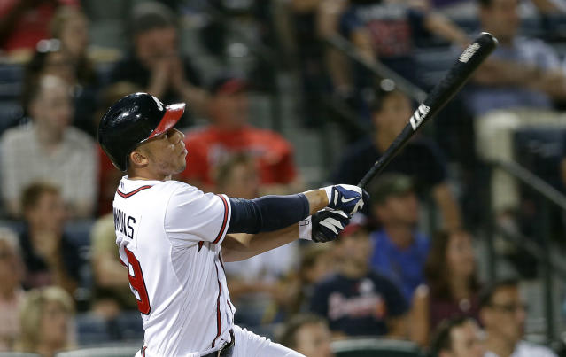 Atlanta Braves' Andrelton Simmons (19) drives in the game-winning run with a triple in the 10th inning of a baseball game against the Colorado Rockies. Atlanta won 9-8 in 10 innings. (AP Photo/John Bazemore)