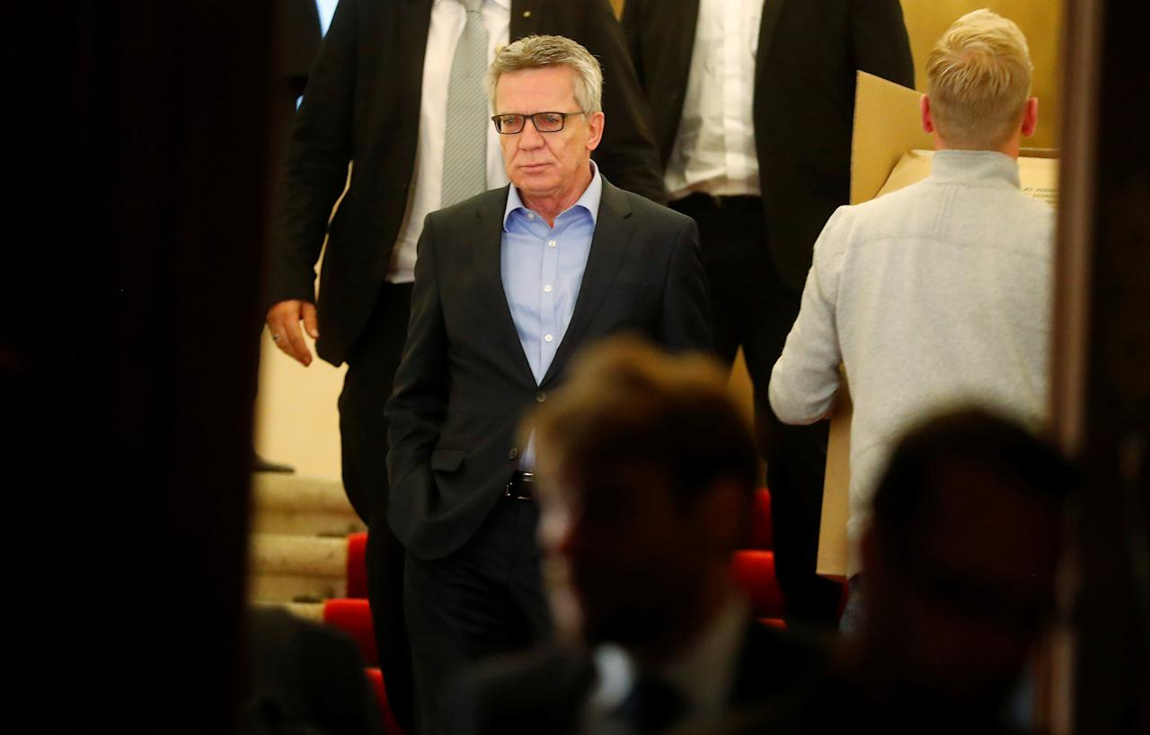 German Interior Minister Thomas de Maiziere of the Christian Democratic Union (CDU) leaves the German Parliamentary Society after exploratory talks about forming a new coalition government in Berlin, Germany, November 17, 2017. REUTERS/Hannibal Hanschke