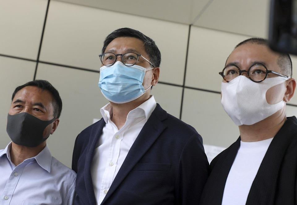Chan Kin-man (centre), along with Lee Wing-tat (left) and Shiu Ka-chun (right) speak to the press after receiving their verdict on Friday. Photo: Xiaomei Chen