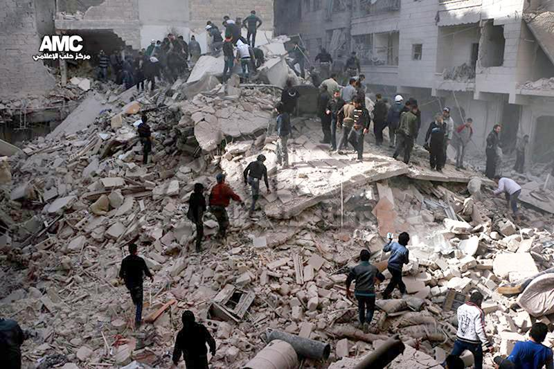 This picture taken on Wednesday, March 5, 2014, provided by the anti-government activist group Aleppo Media Center (AMC), which has been authenticated based on its contents and other AP reporting, shows Syrians inspecting the rubble of a destroyed buildings following a Syrian government airstrike in Aleppo, Syria. (AP Photo/Aleppo Media Center AMC)