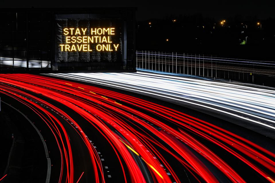 PLEASE NOTE: LONG EXPOSURE EFFECT WAS USED A stay home, essential travel only sign on the M1 Motorway near J25, Long Eaton, Derbyshire. (Photo by Scott Wilson/PA Images via Getty Images)