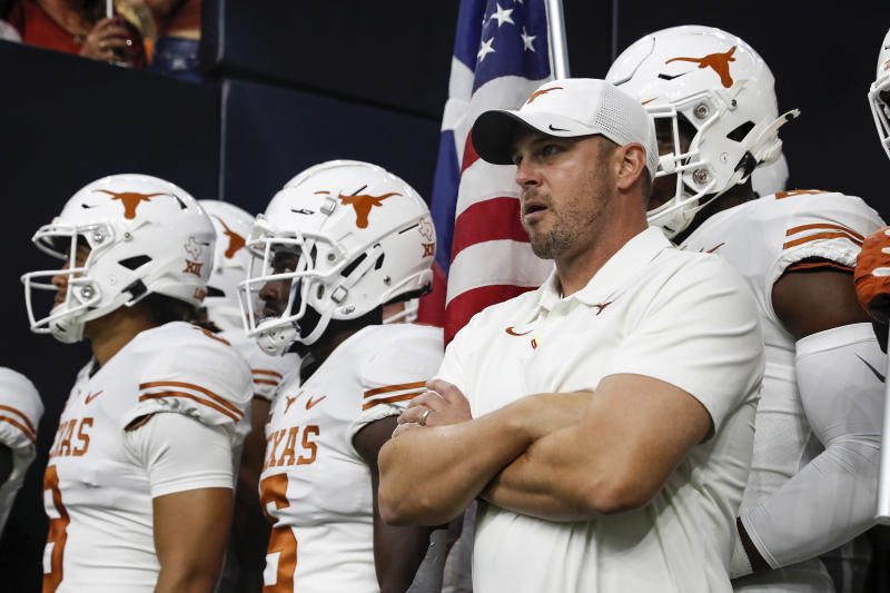 Texas coach Tom Herman prepares to lead the team onto the field before a game against Rice on Sept. 14, 2019. (Tim Warner/Getty Images)