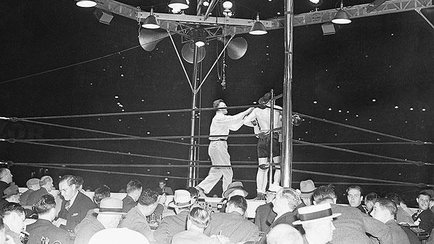 Joe Louis TKO1 Max Schmeling, June 22, 1938 – With tensions rising between the U.S. and Germany because of the Hitler regime's aggressive foreign policy, the fight had societal, as well as sporting implications. Schmeling had beaten Louis in 1936 and Americans badly wanted to see Louis get revenge. He did so in a big way, knocking Schmeling down three times in the first, forcing referee Arthur Donovan to stop it.