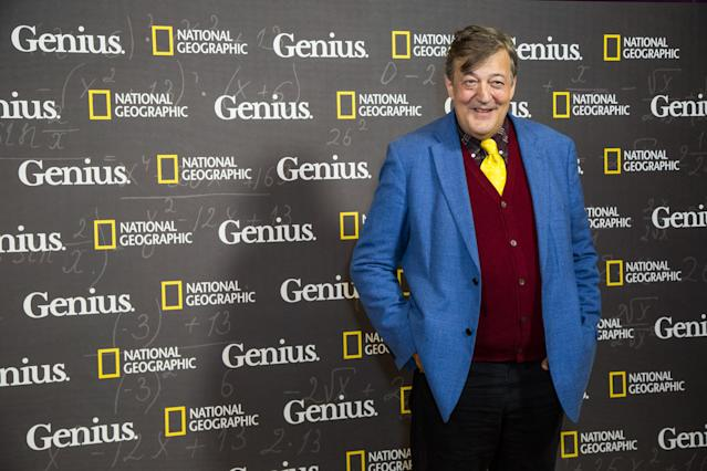 Stephen Fry poses for photographers upon arrival at the premiere of the film <em>Genius</em>, in London in 2017. (Invision/AP)